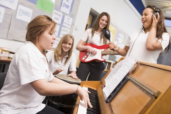 students on different instruments playing together in a band